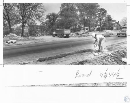 Image: di13259 - Fritz Grause (23) shoveling dirt and inspecting street repairs