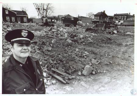 Image: di24298 - Police Capt. Paul Eifert at site of new Covington Police Department building; 20th and Madison