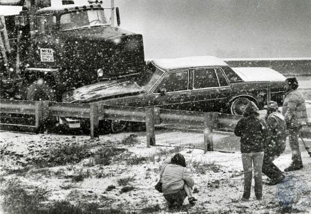 Image: di83165 - Unidentified accident victims check damage after truck pins car against guard rail on ice covered Erlanger....